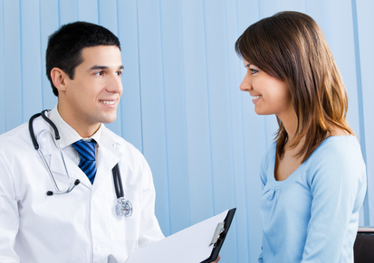 Young doctor and female patient with prescription at office